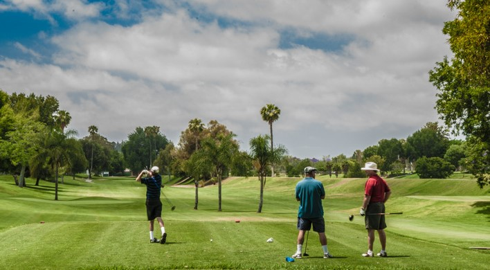 A group of golfers play at River View Golf Course